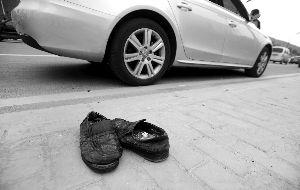 协管员的鞋子还留在现场