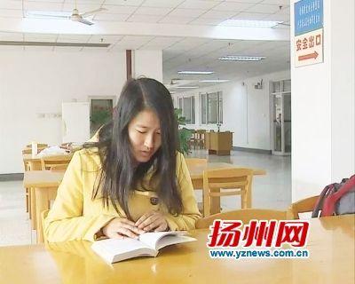 她是扬州大学大四学生陈军